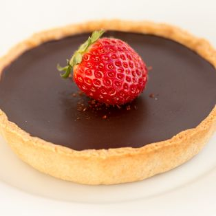 Chilli chocolate tart topped with stawberry