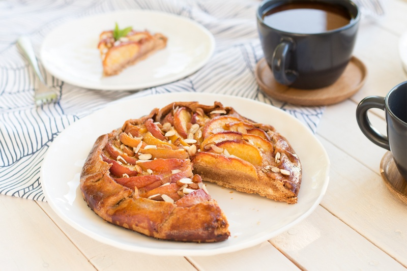 Vegan peach frangipane galette with coffee