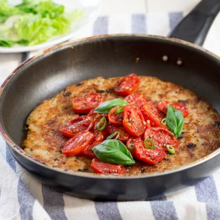 rösti topped with garlicky tomatoes