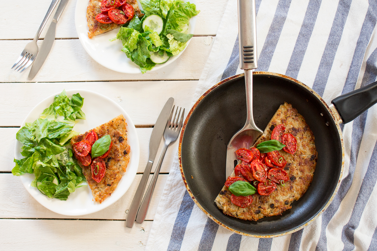 shredded potato rösti topped with garlicky tomatoes for two