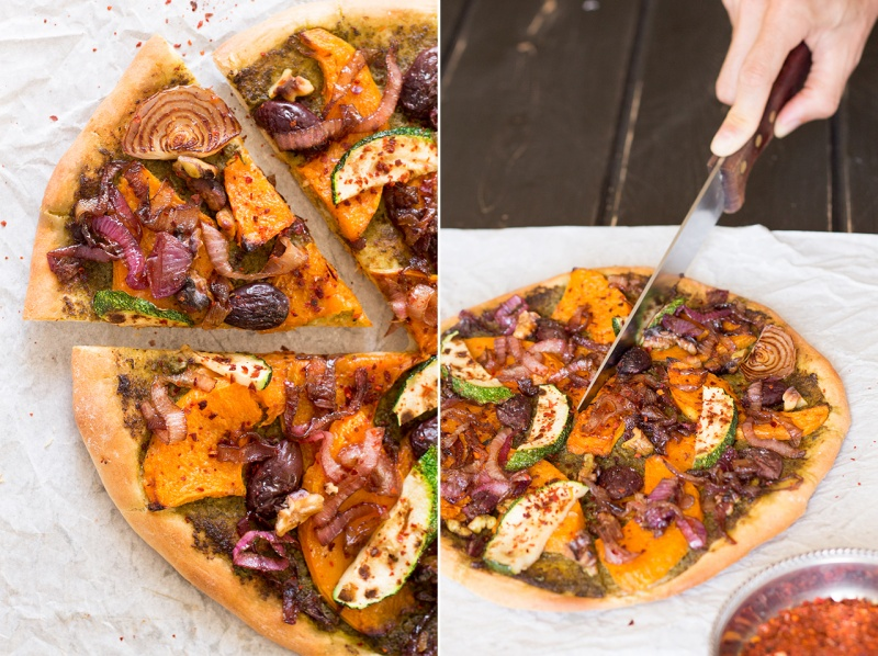 fall pizza with pumpkin being cut