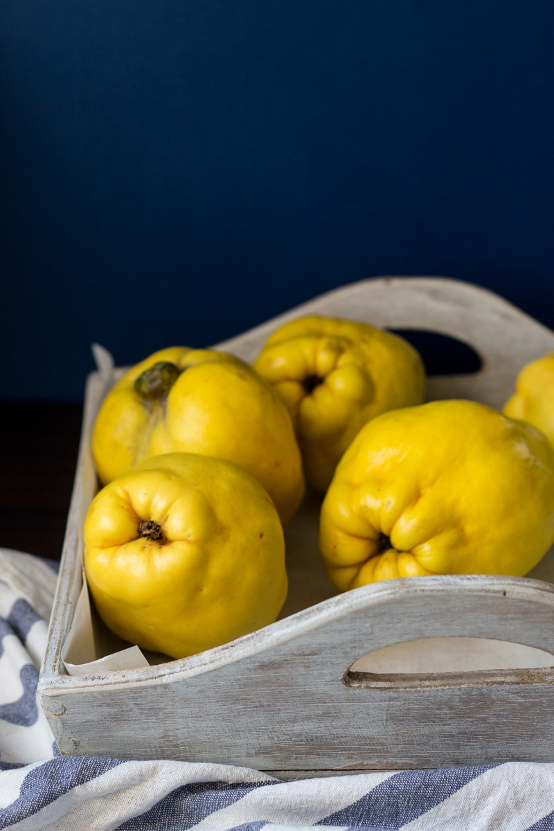 fresh quince on a tray
