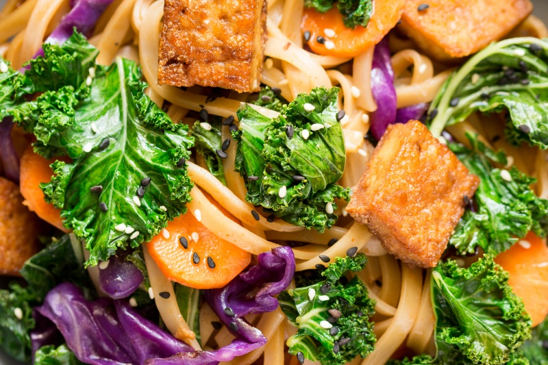 miso maple noodles with kale and tofu close up