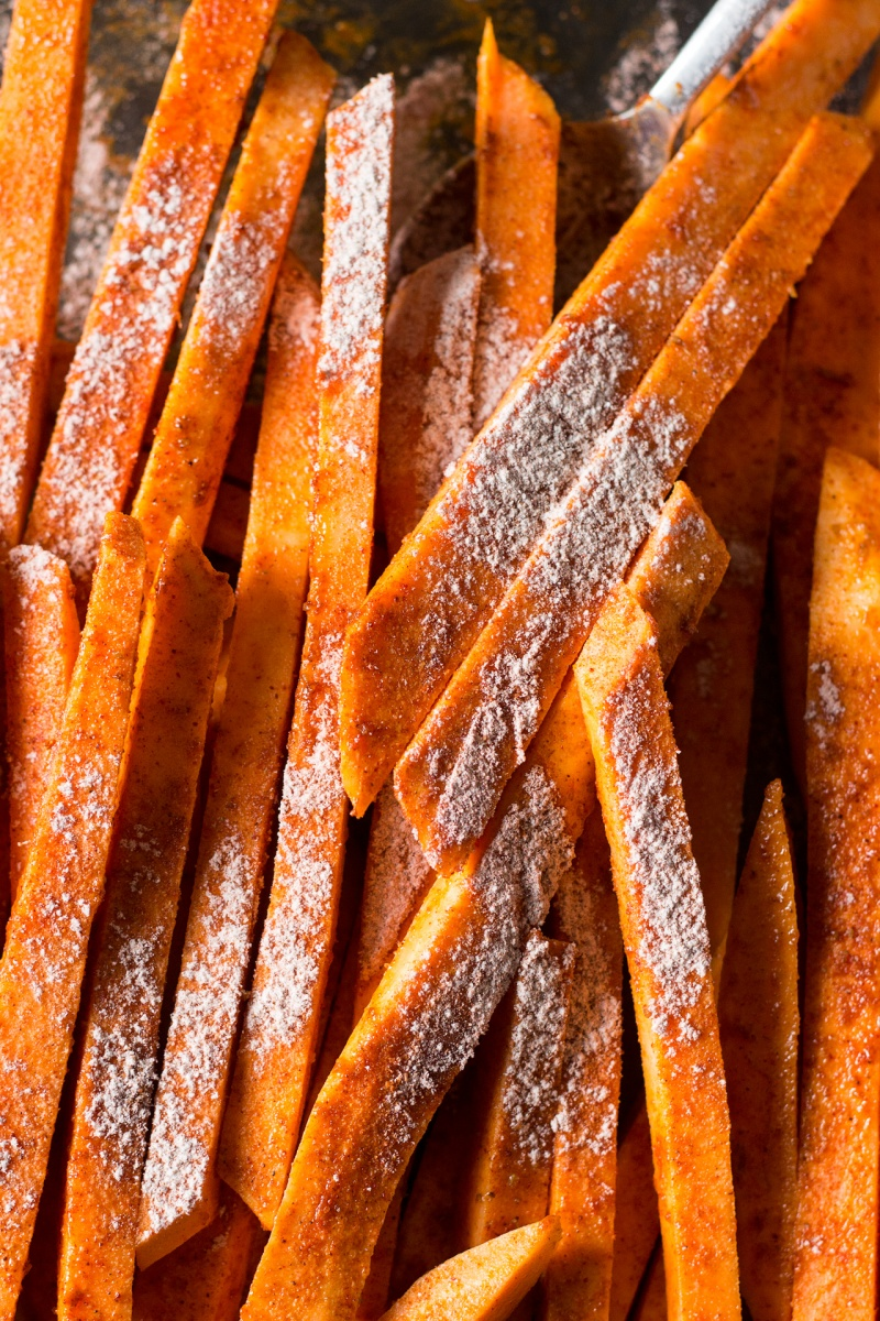 crispy sweet potato fries sprinkled with cornflour and spices