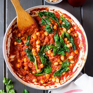 Spanish chickpea and spinach stew in a pan
