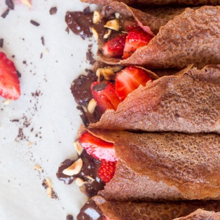 vegan chocolate crepes with hazelnut filling and strawberries