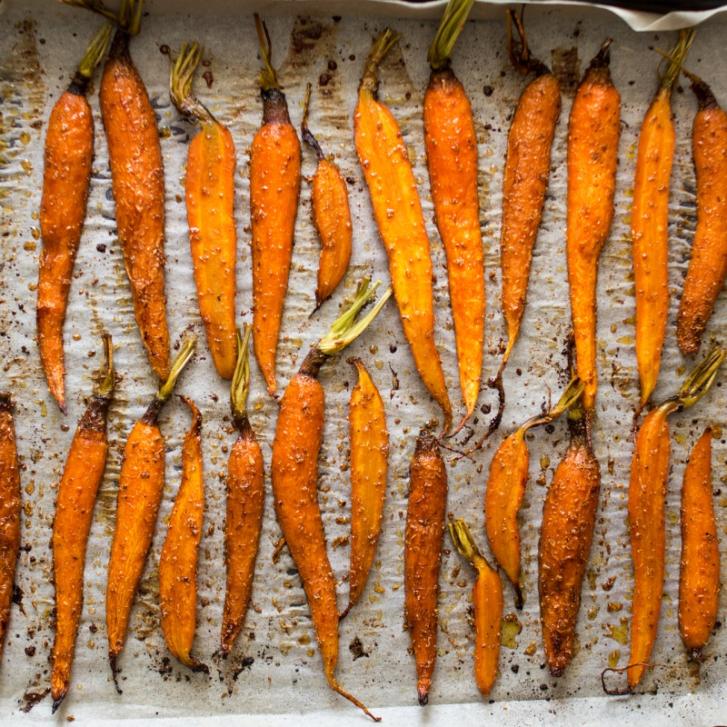 young carrots roasted in spices and maple syrup