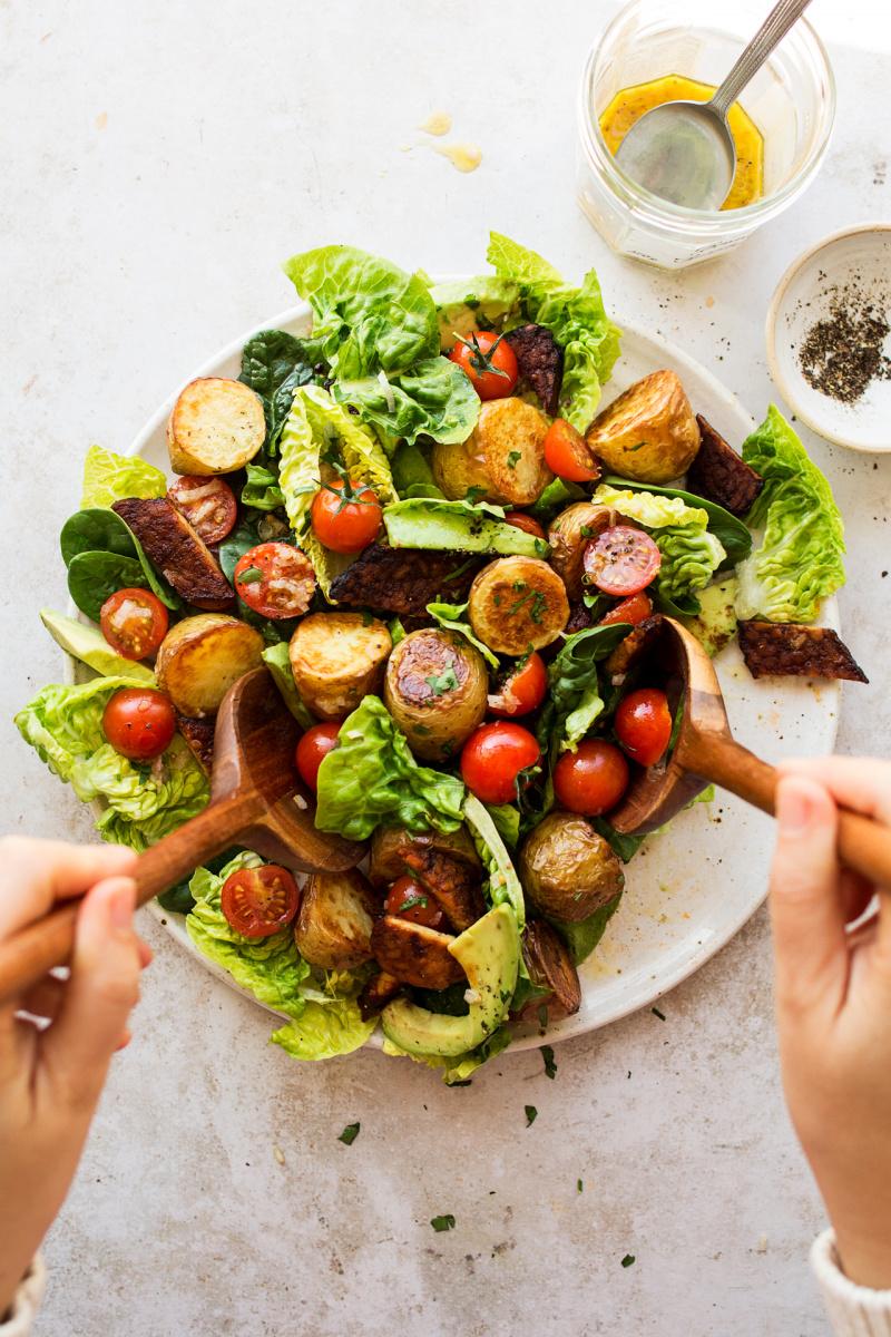 vegan BLT salad mixing