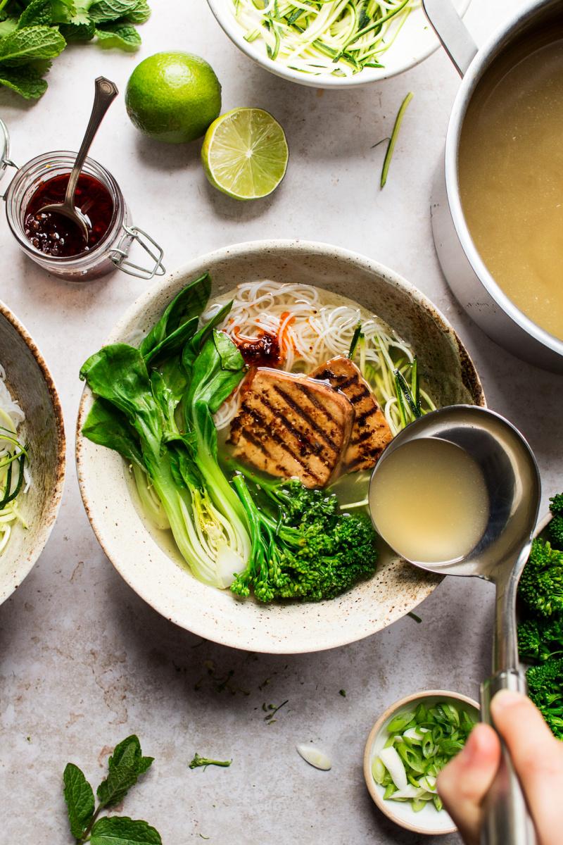 vegan lemongrass soup pouring