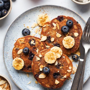 vegan banana blueberry pancakes plate