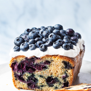 vegan lemon blueberry loaf topped yoghurt