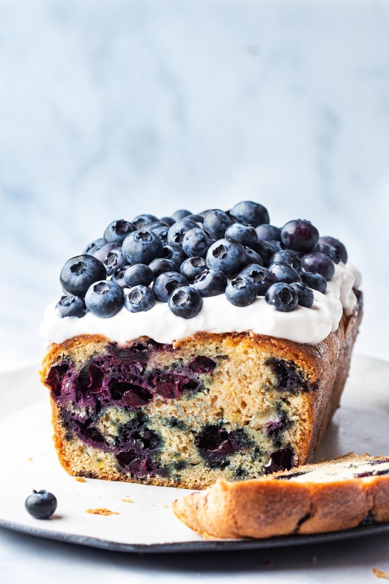 vegan lemon blueberry loaf topped yoghurt
